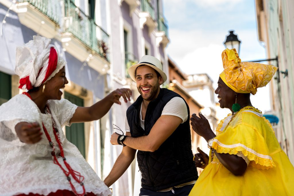 "Tourist dancing with local ""Baianas"" at Festival."