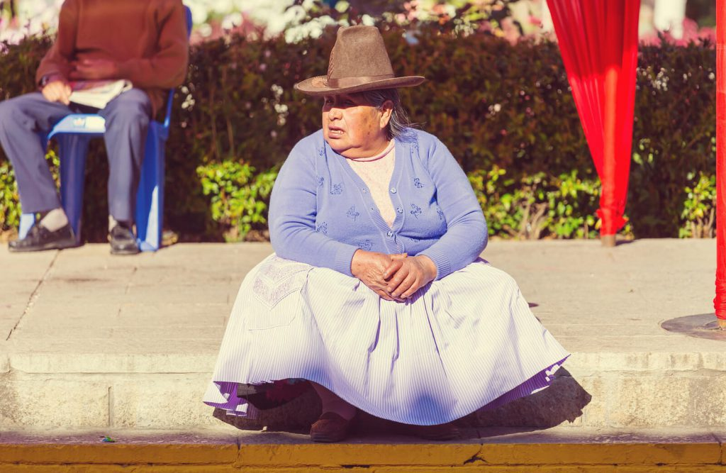 A-lady-rests-at-a-market-in-Peru