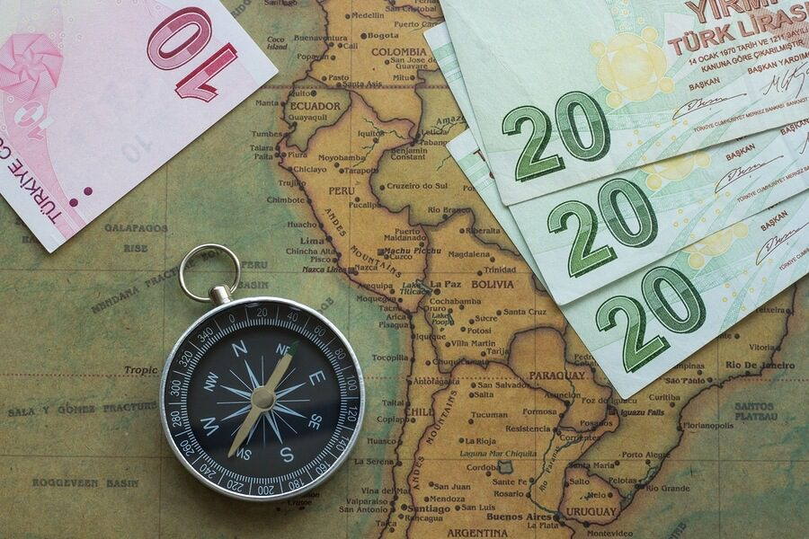 A picture of a map of South America with money laid on it.